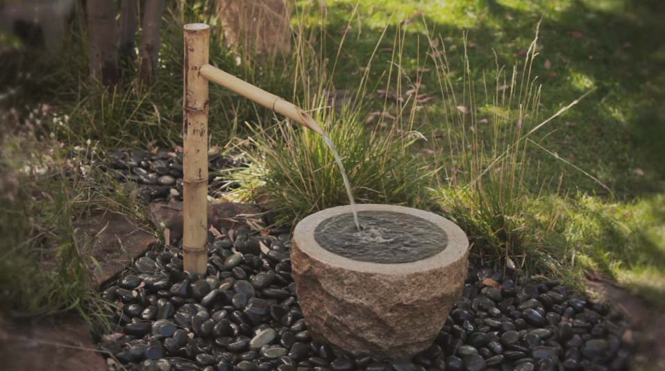 water features - natural looking streams and ponds - focal point landscapes with soothing movement and sound